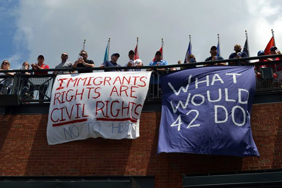 banner with 'immigrant rights are civil rights'